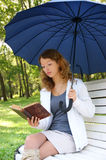 Young woman with old book and umbrella Royalty Free Stock Photography