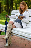 Young woman with old book and umbrella Royalty Free Stock Images
