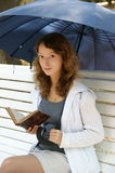 Young woman with old book and umbrella Royalty Free Stock Photos