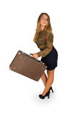 Young woman with an old brown suitcase Stock Image