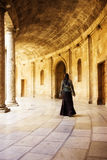 Young woman in old corridors Stock Images
