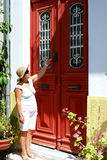 Young woman and old door. On Kythera island, Greece royalty free stock photography