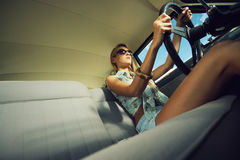 Young woman in an old fashioned car Royalty Free Stock Photo