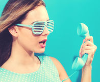 Young woman with old fashioned phone Royalty Free Stock Photo