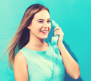 Young woman with old fashioned phone Stock Photos