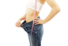 Young woman in old jeans pant after losing weight Stock Photos