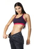 Young woman in old jeans pants after losing weight Royalty Free Stock Images
