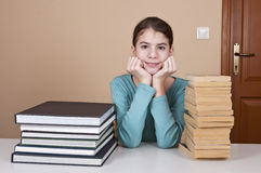 Young woman with old and new books Royalty Free Stock Photography