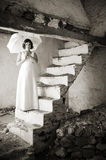 Young woman on old stairs. Royalty Free Stock Photography
