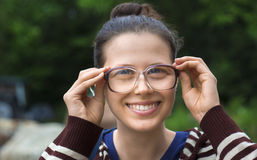 Young woman with old style dusty glasses Royalty Free Stock Image