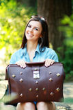 Young woman with old suitcase Royalty Free Stock Images