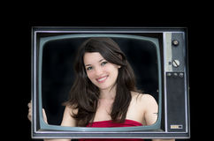 Young woman with old tv frame photo Royalty Free Stock Photos