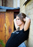 Young woman on old urban background Royalty Free Stock Photo