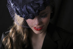 A young woman with an old vintage style hat Stock Photo