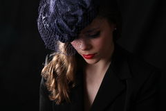 A young woman with an old vintage style hat Stock Image