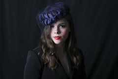 A young woman with an old vintage style hat Royalty Free Stock Photo
