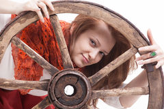 Young woman with an old wagon wheel Royalty Free Stock Images
