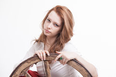 Young woman with an old wagon wheel Royalty Free Stock Photos