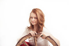 Young woman with an old wagon wheel Royalty Free Stock Photography