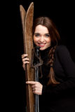 Young woman with old wooden skis Stock Photography
