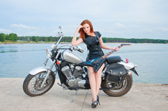 Young Woman On A Motorcycle Stock Image