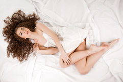 Young Woman On Bed Stock Image