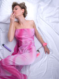 Young Woman On Bed With Strawberry And Hand Cuffs Royalty Free Stock Photos