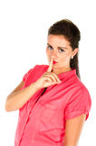 Young woman with one finger on her lips Stock Photos