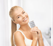 Young woman with one pack of pills Royalty Free Stock Photo