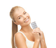 Young woman with one pack of pills Royalty Free Stock Image