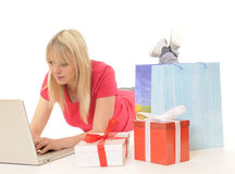 Young woman while online-shopping Stock Image
