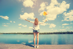 Young woman open arm with holding  colorful balloons Stock Photography