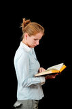Young woman and an open book Royalty Free Stock Image
