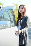 Young woman open the car door Stock Photos
