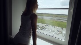 Young woman open curtains at early morning. stock video