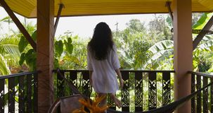 Young Woman Open Door Walking Out On Summer Terrace With Beautiful Tropical Landscape, Back Rear Of Beautiful Girl Enjoy. Morning View Slow Motion 60 stock video