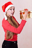 Young woman with open gift box Royalty Free Stock Images
