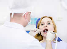 Young woman with open mouth during drilling treatm Stock Photo