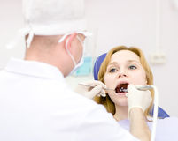 Young woman with open mouth during drilling treatment at the den Royalty Free Stock Photos