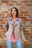 Young woman with open mouth wants to eat ice cream. Street Stock Photos