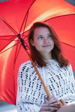 Young woman with open umbrella at hand Stock Image