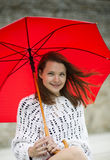 Young woman with open umbrella at hand Royalty Free Stock Images