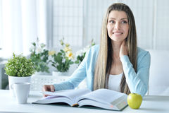 Young woman with opened book Royalty Free Stock Photo
