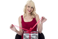 Young Woman Opening a Christmas Present Royalty Free Stock Photo