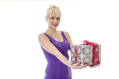 Young Woman Opening a Christmas Present Royalty Free Stock Images