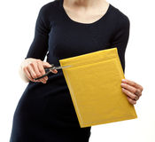 Young woman opening envelope Royalty Free Stock Photos