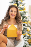 Young woman opening envelope near christmas tree Royalty Free Stock Photo