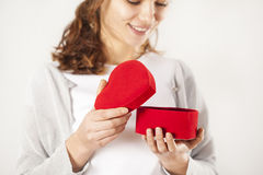 Young woman opening gift box. Young woman opening  gift box Stock Photo