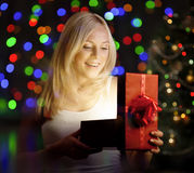 Young woman opening gift box Royalty Free Stock Images