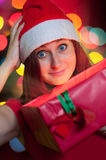 Young woman opening gift box Royalty Free Stock Photos